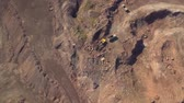 pit mine : Aerial view of working excavator in the opencast mine. Camera flight over industrial landscape. Stock Footage