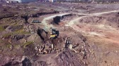 coal mine : Aerial view of working excavator in the opencast mine. Camera flight over industrial landscape. Stock Footage