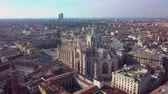 мадонна : Aerial drone footage of famous statue on cathedral Duomo in Milan Italy