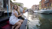 карнавал : Beautiful girl in dress riding on gondola, Venice, Italy.