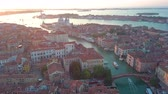 marco : Aerial panoramic view of cityscape of Venice, Grand Canal in famous historical City of Water, clear blue sky, landscape panorama of Italy from above, Europe Stock Footage