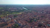 flat roof : Panoramic aerial drone view of medieval city of love Verona, Pietra bridge and Adige river Stock Footage