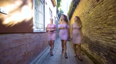 eski moda : Three young women tourists on summer vacation girl friends walking Stok Video
