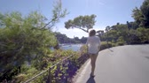 wave : girl walking and looking down on the bay portofino italy Stock Footage