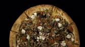 mostaza : Rotating pizza with smoked sausage and olives on a black background. Top view center orientation Archivo de Video