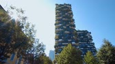 lombardia : Milan, Italy - September 26, 2018: Modern and ecologic skyscrapers with many trees on every balcony
