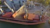 processado : Aerial view of big grain elevators on the sea. Loading of grain on a ship. Port. Cargo ship
