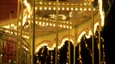 nostalgie : Fascinating flashing lights dark night sky illumination of vintage merry go round fair carousel ferris wheel at carnival