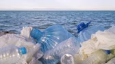 recyklace : Pollution: garbages, plastic, and wastes on the beach after winter storms