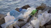 odpady : Plastic pollution in ocean environmental problem. Plastic cups,carrier bags, bottles and straws dumped in sea