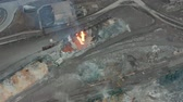 melting of metal : Pour molten slag from the diesel locomotive tank at a metallurgical plant. Aerial view Stock Footage