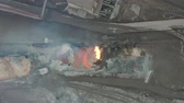 smelting : Pour molten slag from the diesel locomotive tank at a metallurgical plant. Aerial view Stock Footage