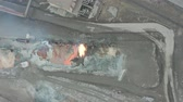irony : Pour molten slag from the diesel locomotive tank at a metallurgical plant. Aerial view Stock Footage