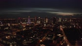 warschau : 4K. Aerial shot of Warsaw city metropolis skyline at night. Spectacular aerial view of skyscraper city buildings at night. Stockvideo