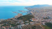 sol : Aerial view of Malaga Costa del sol with the sea and mountains surrounding it.