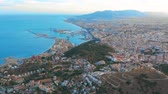 sol : Malaga, Spain. A panorama shot by a drone over Malaga. City buildings and seaside view. Ships and port.