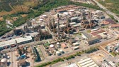 petrochemical : Aerial view. Oil refinery, chemical factory and power plant with many storage tanks and pipelines. Stock Footage
