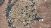 zwerfvuil : The Bulldozer Compacts the Garbage on the Landfill. Wastes of Human Life. Aerial View.