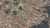 escavadeira : Aerial view. Garbage pile in trash dump. Environmental pollution from consumerism household. Vídeos