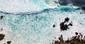 uluwatu : Aerial footage of incredible ocean waves. Drone view how waves crashing on shore