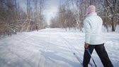 фитнес : Woman Cross-Country Skiing Alone
