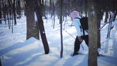 экспедиция : Lonely Woman Snowshoeing in Forest on a Beautiful Winter Day