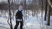 pretty : Lonely Woman Snowshoeing in Forest on a Beautiful Winter Day