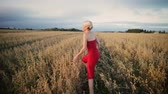shaky : LIFE IS FUN !!! Happy Blonde Woman Running in Field with her Boyfriend