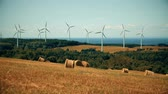 but : Seamless Loop Motion-Photo Cinemagraph of many Wind Turbine, but ONLY one Spinning