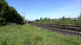 sleepers : The approaching passenger train. Summer video of the city on the background of nature. Movies with the outside of the train. With sound. Stock Footage