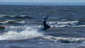embarque : SLOW MOTION: Kiteboarder rides on the board on the waves. Summer sunny evening. Stock Footage