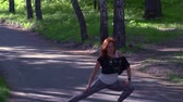 рыжеволосый : SLOW MOTION: The red-haired woman kneads her feet after running. Morning invigorating charging.