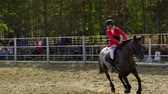 jokey : Undory, Ulyanovsk Region, Russia - September 2, 2018: A jockey girl riding a horse at equestrian competitions. Slow motion. Stok Video
