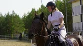 Undory, Ulyanovsk Region, Russia - September 2, 2018: A jockey girl riding a horse at equestrian competitions. Slow motion. Wideo