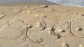 aviso : Word Sea written on beach