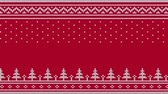 évjárat : Animated looped knitted sweater ornament - spruce, falling snow, national patterns. White on a red background.
