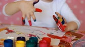 finger painting : The child draws. Gouache and paints. Baby drawing. Creation. Abstraction Stock Footage