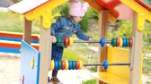 pár : Child girl plays in the playground in different games. Entertainment for children. Development of preschoolers. Walk baby
