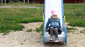 sertés : Sad and dissatisfied child girl on the playground expresses dissatisfaction