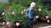 şakayık : Child girl poses for a photo as a model and dances in the peony garden.