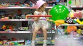 baby store : Childrens shop with toys. A child in a supermarket sits in the shopping cart