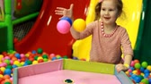 emergere : Child girl playing on the playground with colorful balloons. Baby plays in the room for games