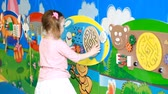 emergere : Baby girl playing in the playground. Educational games for children Filmati Stock