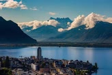 timelapse of montreux with lake of geneva and swiss alp in the background
