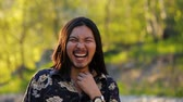 charming : A long haired handsome hippy man laughing happily in the mountains against a beautiful sunset in Slow motion