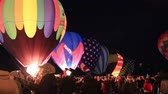 templombúcsú : Albuquerque, NM - October 5, 2013 - Inflating hot air baloons before sunrise at the annual Albuquerque Balloon Fiesta.
