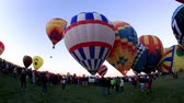 meksyk : Albuquerque, NM - October 5, 2013 - Inflating hot air baloons before sunrise at the annual Albuquerque Balloon Fiesta.