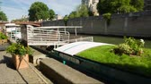 catholic church : PARIS, FRANCE - JUNE 5, 2017: Famous landmark Notre Dame de Paris church cathedral daylight tilt and pan video with a barge standing near the cobbled stone of the Seine River embankment