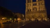 catholic : PARIS, FRANCE - JUNE 5, 2017: Famous landmark Notre Dame de Paris cathedral at twilight tilt and pan video