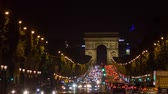 triumphal arch : PARIS, FRANCE - JUNE 10, 2017: A trafic on Chaps Elysees at night with triumphal arch on background Stock Footage